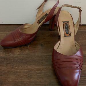 Vintage leather sling back heels.